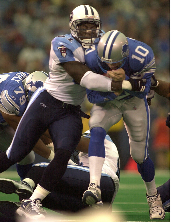 . Detroit Lions QB Charlie Batch is sacked by the Tennessee Titans Josh Evans Sunday, October 21, 2001 at the Pontiac Silverdome. The Titans went on to  defeat the Lions 27-24.