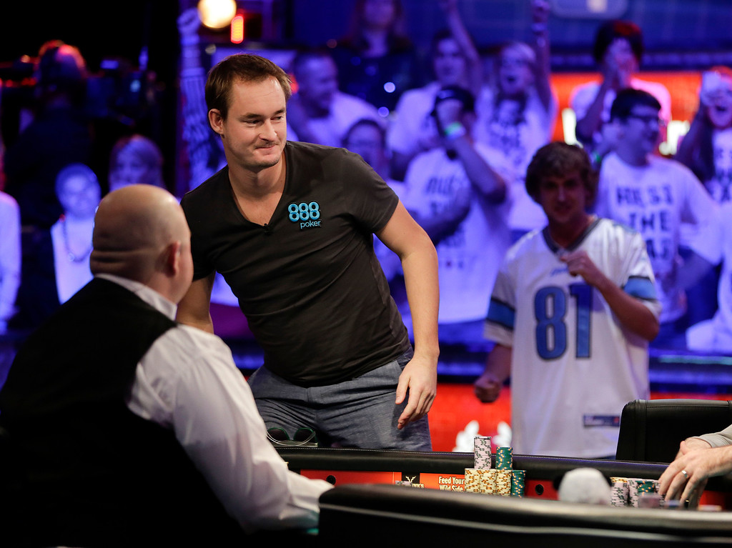 Description of . Michiel Brummelhuis of the Netherlands, left, stands up from the table after being eliminated during the World Series of Poker Final Table, Monday, Nov. 4, 2013, in Las Vegas. (AP Photo/Julie Jacobson)