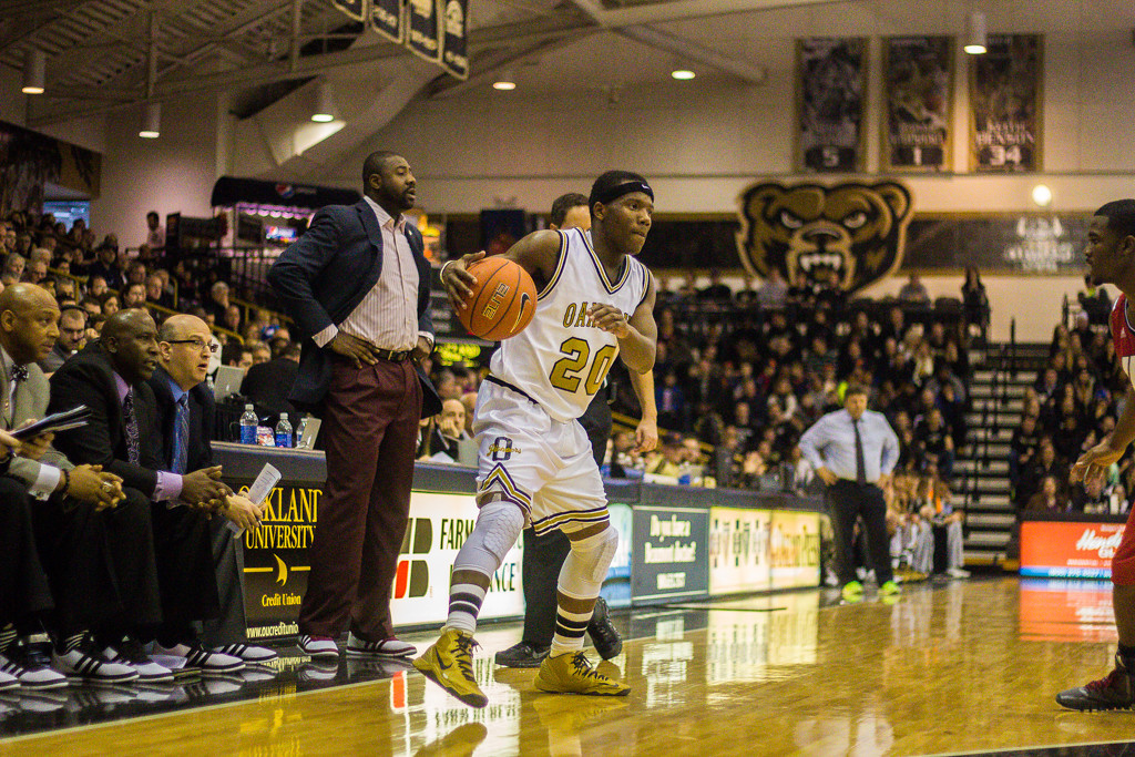 Description of . Felder looks for a route to the hoop. Photos by Dylan Dulberg/The Oakland Press