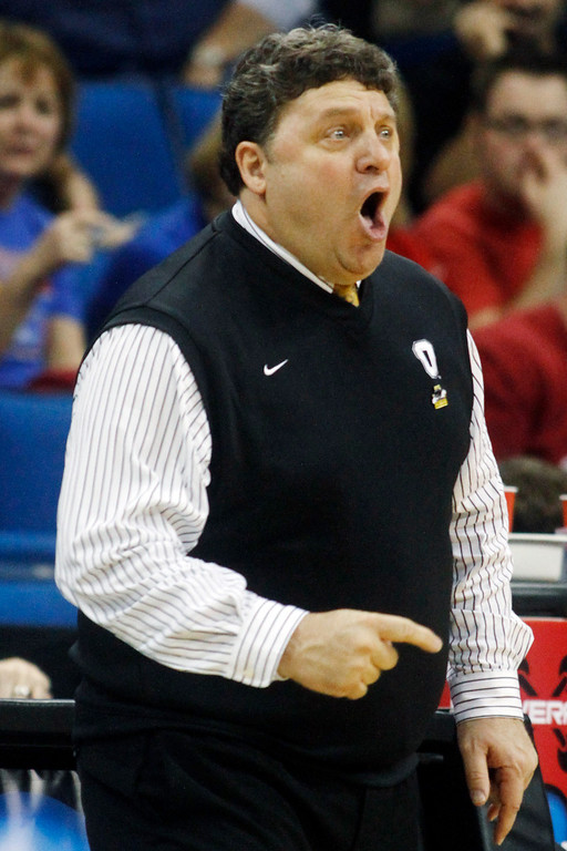 Description of . Oakland, Mich. head coach Greg Kampe reacts to action against Texas in the first half of a West Regional NCAA tournament second round college basketball game, Friday, March 18, 2011 in Tulsa, Okla. (AP Photo)