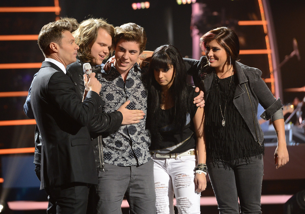Description of . AMERICAN IDOL XIII: Sam Woolf is eliminated on AMERICAN IDOL airing Thursday May 1 (9:00-9:30 PM ET/PT) on FOX.  L-R: Ryan Seacrest, Caleb Johnson, Sam Woolf, Jena Irene and Jessica Meuse.   CR: Michael Becker / FOX. Copyright 2014 / FOX Broadcasting.