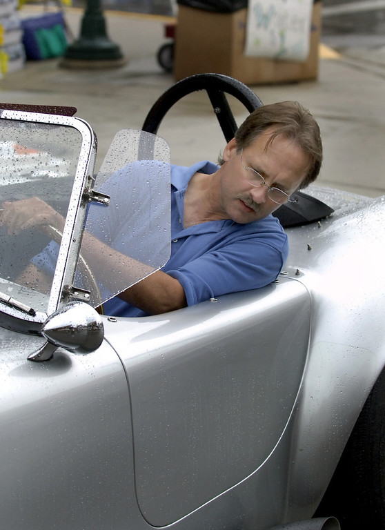 Description of . Ross Weaver, of Commerce, pulls his 1965 replica Cobra into a parking spot in downtown Birmingham Saturday morning during the Woodward Dream Cruise.