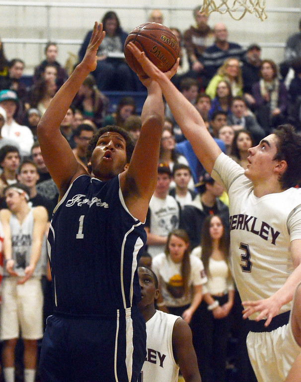 Description of . Farmington's #1 Justin Banks goes up for a shot while defended by Berkley's #3 Noah Witus during their game at Berkley High School, Friday January 31, 2014.  Farmington went on to win 79-76. (Vaughn Gurganian-The Oakland Press)