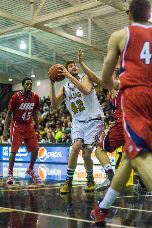 Description of . Petros prepares to make a lay-up. Photos by Dylan Dulberg/The Oakland Press