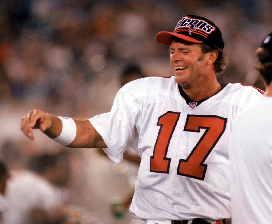 . Atlanta Falcons aging quarterback Steve DeBerg laughs with teamates while taking a break during his game against the Detroit Lions at the Silverdome Aug 13.