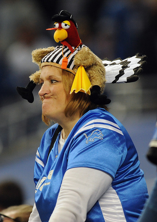. Renee Tocco of Warren, Mich., shows her disgust after the Houston Texans kicked a field goal in overtime to beat the Detroit Lions,  34-31.  Photo taken on Thursday, November 22, 2012, at Ford Field in Detroit, Mich.  (Special to The Oakland Press/Jose Juarez)