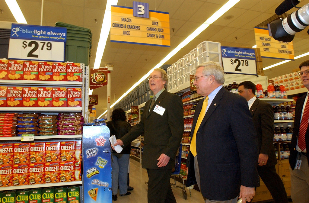 Description of . Kmart Executive Vice President of Merchandising Cecil Kearse, left, gives a store tour to Oakland County Executive L. Brooks Patterson, Thursday, March 21, 2002, in Bloomfield Township, Mich.  Patterson, who said he was going to shop as well, recently said that Oakland County will continue to support Kmart by buying products from them.  Patterson not only purchased 50 Kmart Cash Cards worth 50 dollars each to distribute to Oakland County employees selected as Employees of the Month, but also picked up a couple of toy bones for his dog.