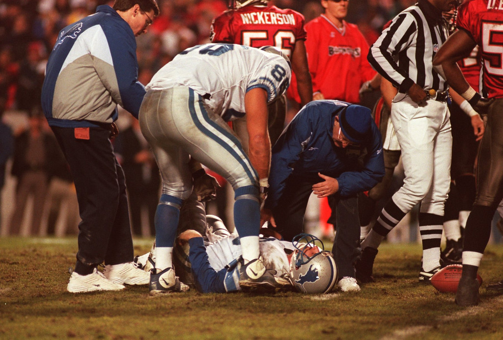 . Lions QB Scott Mitchell lies motionless on the Tampa Bay Buccaneers field , in a frightening  scene that was to bring instant fear and a reminder of the severe injuries the Lions have suffered this season. Mitchell was taken from the field , he suffered from a mild concussion.