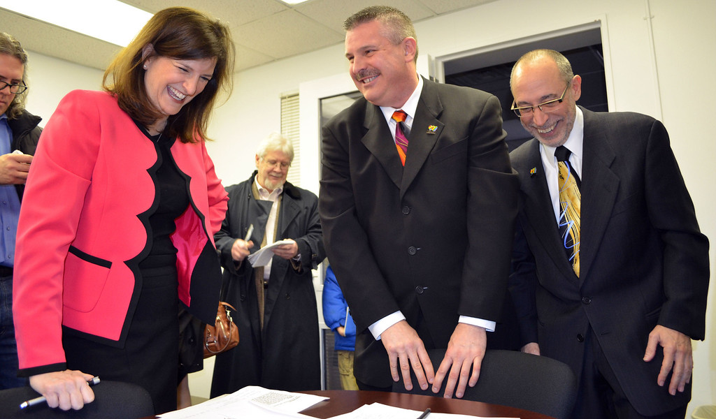 Description of . Oakland County Clerk Lisa Brown, James Ryder and Frank Colasonti Jr. and James Ryder after Brown and the couple signed the papers for the county's first same-sex marriage. Dustin Blitchok-The Oakland Press