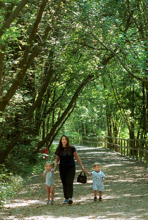 Description of . Jonna Foeller, of Rochester, walks with her children, Brenna (left), 3, and Richard, 2, at the hiking trail at Yates Cider Mill in Rochester Hills Friday.