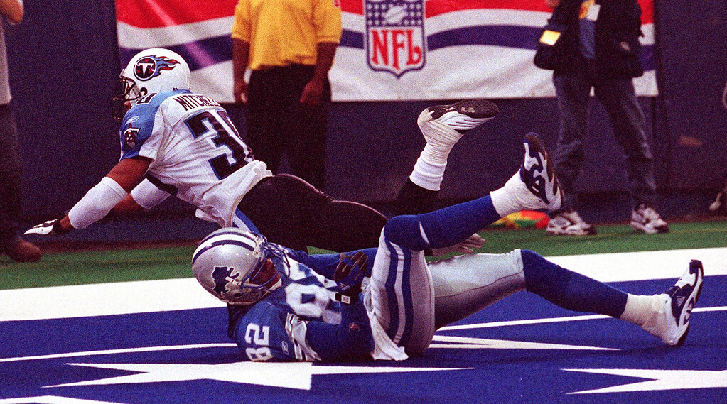 . Tennessee Titan corner back Donald Mitchell (top) comes down on Detroit Lions wide receiver  Germane Crowell during this play which torn Crowell\'s knee tendon in the Lions 27-24 loss at the Pontiac Silverdome Sunday.  Crowell was taken off the field on a cart and will likely be out the season.