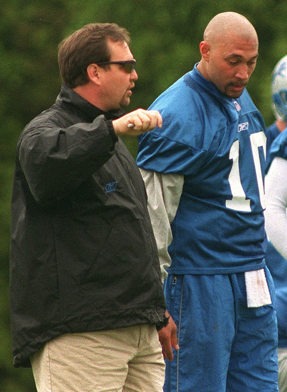. Detroit Lions Head Coach Marty Mornhinweg (left) talks with quarterback Charlie Batch during a recent practice at the Pontiac Silverdome.