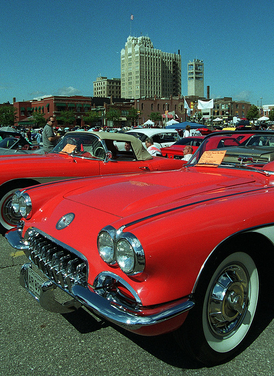 Description of . Two classic Corvette\'s sit in the parking lot of the Phoenix Plaza during Friday night\'s kick-off of this year\'s Woodward Ave. Dreram Cruise in Pontiac.