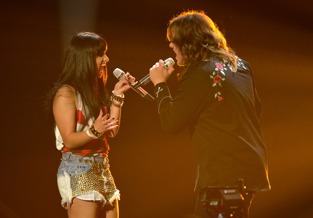 Description of . AMERICAN IDOL XIII: L-R: Jena Irene and Caleb Johnson perform on AMERICAN IDOL XIII airing Wednesday, April 16 (8:00-10:00PM ET /PT) on FOX. CR: Frank Micelotta / FOX. Copyright 2014 / FOX Broadcasting.