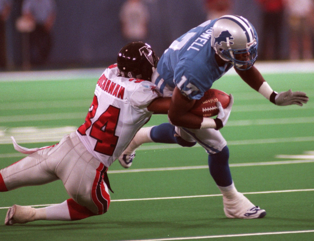 . The Detroit Lions\' Germane Crowell (right) gets taken down by the Atlanta Falcons\' CB Ray Buchanan during a preseason-game at the Silverdome August 14.
