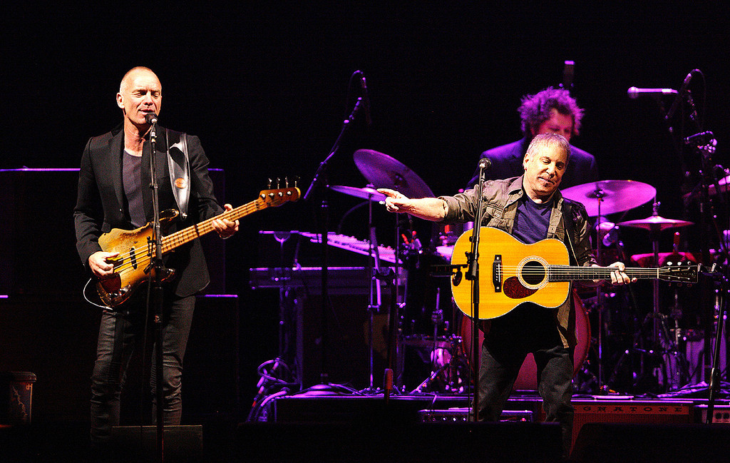 Description of . Sting and Paul Simon perform in their On Stage Together tour at The Palace of Auburn Hills, Wednesday, Feb. 26, 2014. Photo by Ken Settle