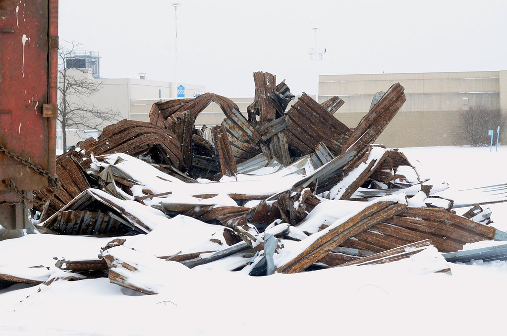 Description of . Pile of scrap metal at the  Cinema III behind the Summit Place Mall in Waterford Township.    Thursday, February 6, 2014.  Tim Thompson-The Oakland Press