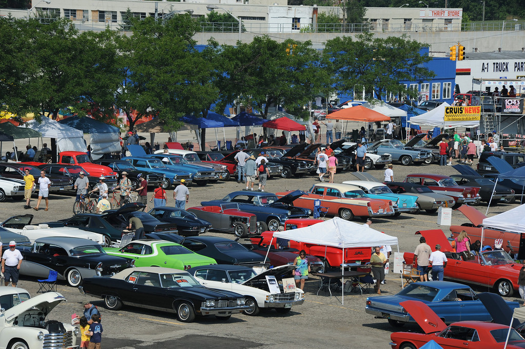 Description of . The Woodward Dream Cruise, as seen with Lot 9 in the foreground, in downtown Pontiac, Mch.  Photo taken on Saturday, August 15, 2009.  (The Oakland Press/Jose Juarez)