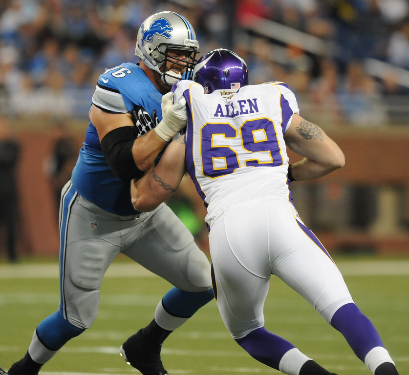 . Detroit Lions tackle Jeff Backus, left, tries to hold back Minnesota Vikings defensive end Jared Allen during first quarter action.  Photo taken on Sunday, September 30, 2012, at Ford Field in Detroit, Mich.  (Special to The Oakland Press/Jose Juarez)