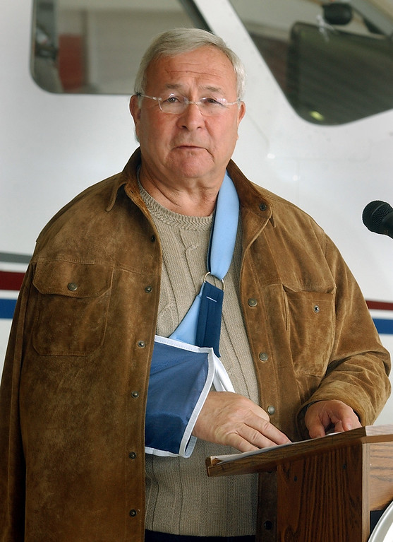 Description of . Oakland County Executive L. Brooks Patterson, his right arm in a sling, speaks at a press conference at Oakland County International Airport, Friday April 30, 2004. According to sources, Patterson sustained the injury after falling in the shower.