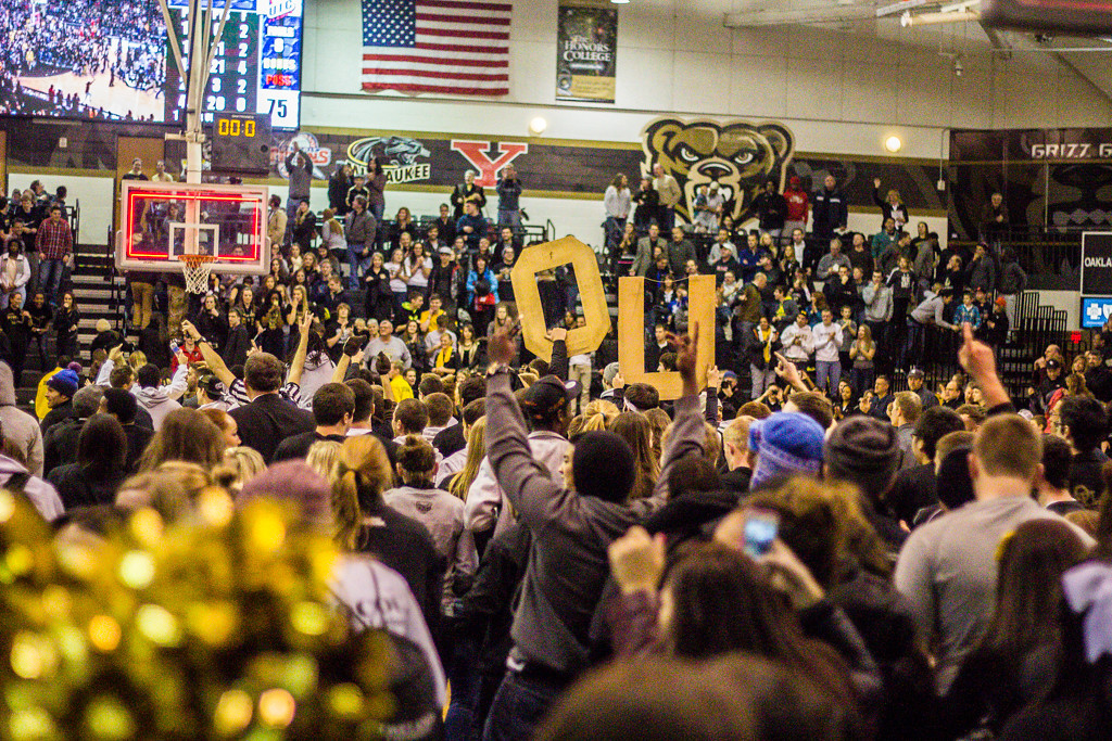 Description of . Fans, students storm the court after Mondy's three point buzzer-beater. Photos by Dylan Dulberg/The Oakland Press