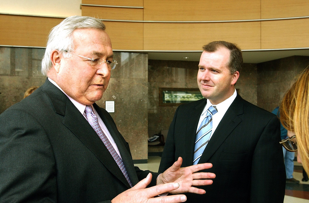 Description of . Oakland County Executive L. Brooks Patterson and Speaker of the HouseCraig DeRoche talk about Michigan's Single Business Tax at the Oakland County Circuit Court building.