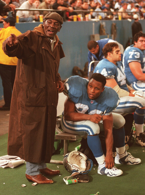 . William Sanders congratulates his son Detroit Lions running back Barry Sanders after scored his 100 NFL touchdown during Sunday\'s game against the Indianapolis Colts. The Lions won 32-10.