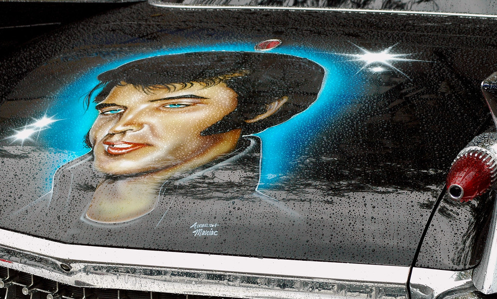 . Despite the rain Saturday morning, Elvis didn\'t bother with an umbrella, as seen here in downtown Birmingham.