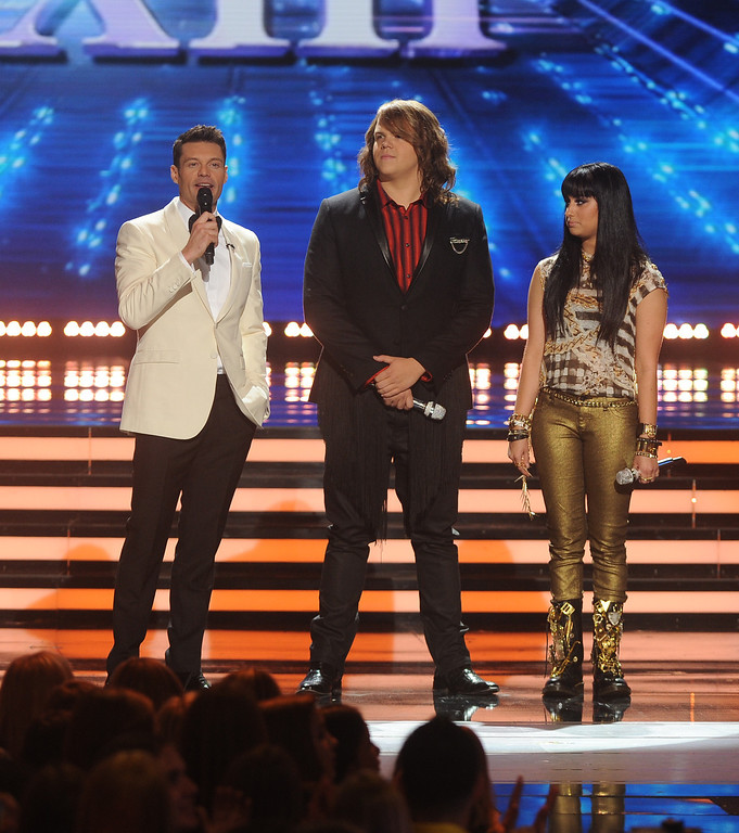 Description of . AMERICAN IDOL XIII: L-R: Ryan Seacrest, Caleb Johnson and Jena Irene on AMERICAN IDOL XIII at the NOKIA THEATRE L.A. LIVE airing Tuesday, May 20 (8:00-9:00 PM ET / PT) on FOX.  CR: Michael Becker / FOX. Copyright 2014 / FOX Broadcasting.