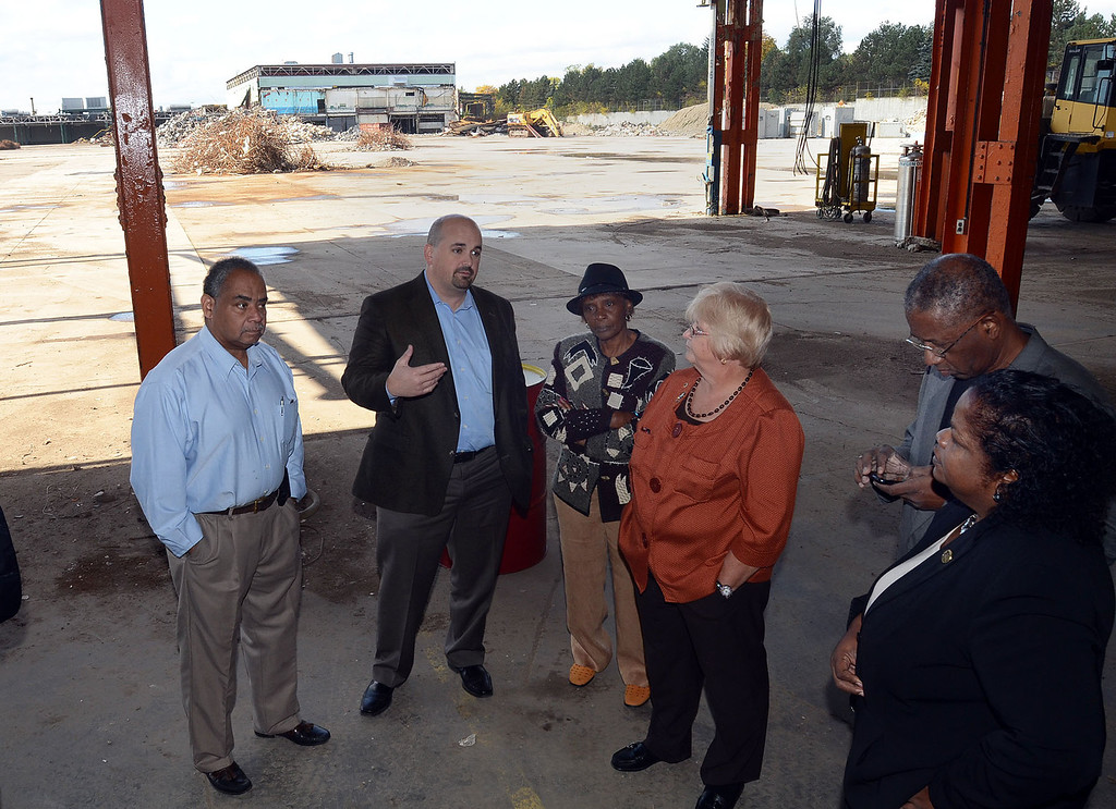 Description of . Chuck Rizzo, President and CEO of Rizzo Environmental Services, (second from left) talks with Pontiac City Council members about a proposal to have a waste transfer station at the former Pontiac Fiero plant, pictured Wednesday October 16, 2013. (Oakland Press Photo:Vaughn Gurganian)