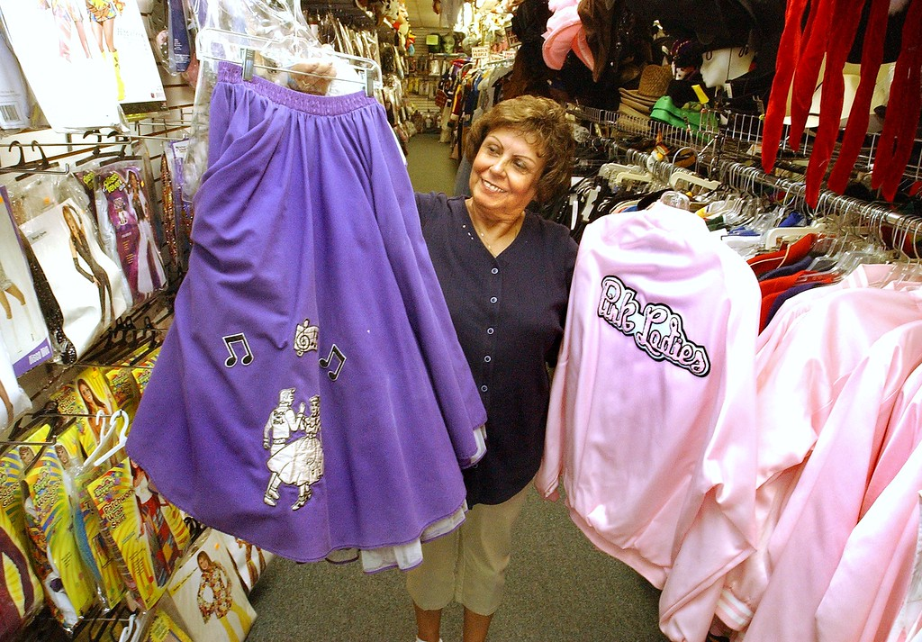. Gloria Randall shows some of the \'50\'s clothes that you get for the Dream Cruise at Sutton\'s Costumes in Waterford Township.   The Oakland Press/TIM THOMPSON