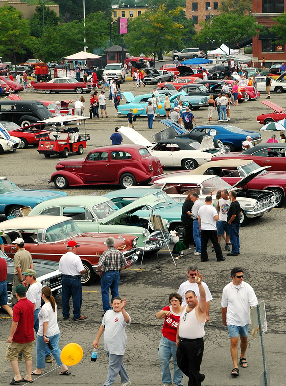 Description of . Lot 9 in Pontiac was full of cars Saturday for the Woodward Dream Cruise.  All day cars came and went as drivers rotated between relaxing and cruising along the Avenue.
