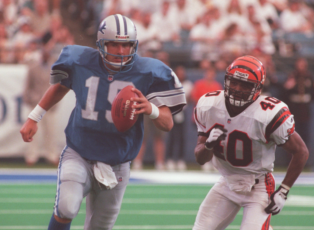 . Detroit Lions quarterback Scott Mitchell scrambles away from Cincinnati Bengals safety Myron Bell.  Mitchell went 15 of 31 for 204 yards and two interceptions. The Bengals beat the Lions, 34-28 in overtime.