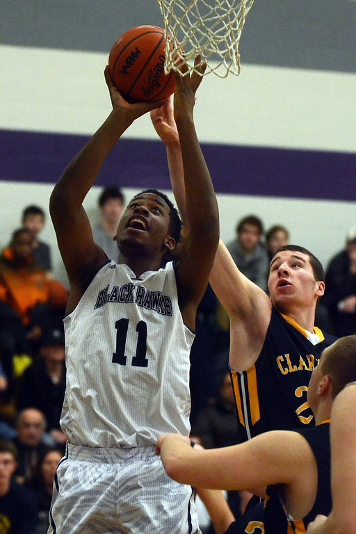 Description of . Bloomfield Hills #11 Yante Maten goes up for a shot while guarded by Clarkston's #25 Michael Nicholson during their game at Bloomfield Hills High School, Tuesday January 28, 2014. Bloomfield Hills went on to win the game 74-62. (Vaughn Gurganian-The Oakland Press)