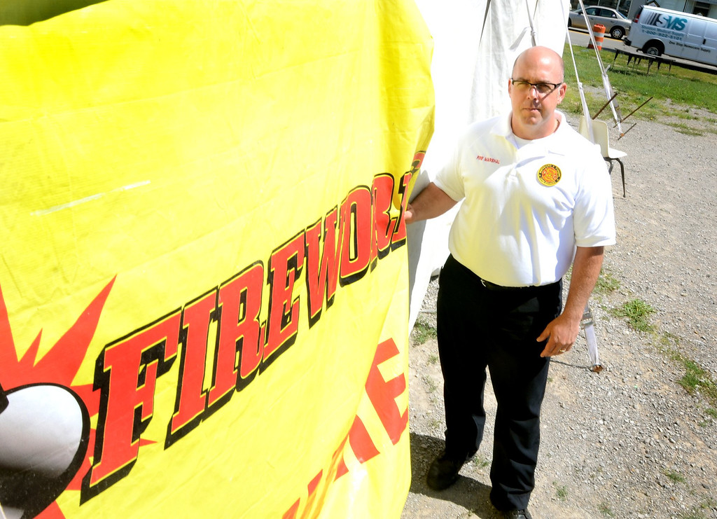 Description of . Waterford Township Fire Marshall Matt Covey at a fireworks stand in Waterford.    Wednesday, July 24, 2013.  The Oakland Press/TIM THOMPSON