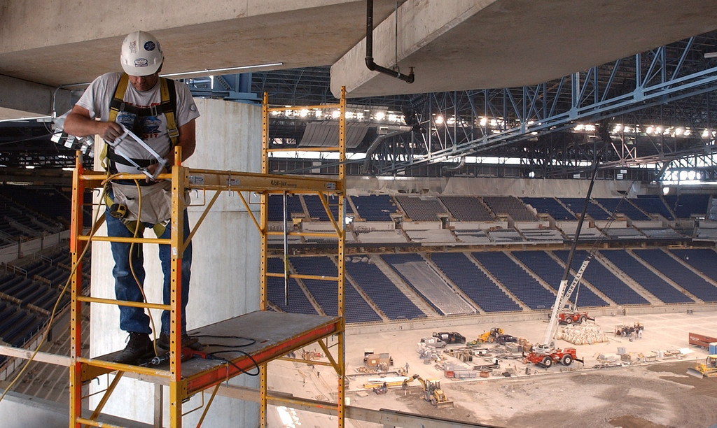 . Dave Barnhart of Royal Oak electrican for Hendricks Electric install pipe for the TV montors in the upper level of new Ford Field, future site of the NFL Detroit Lions in downtown Detroit.