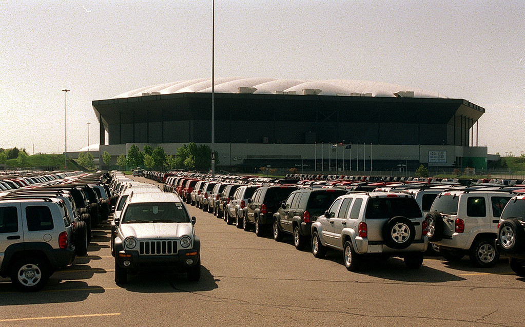 Description of . Jeep Libertys line the northern portion of the Pontiac Silverdome Wednesday.
