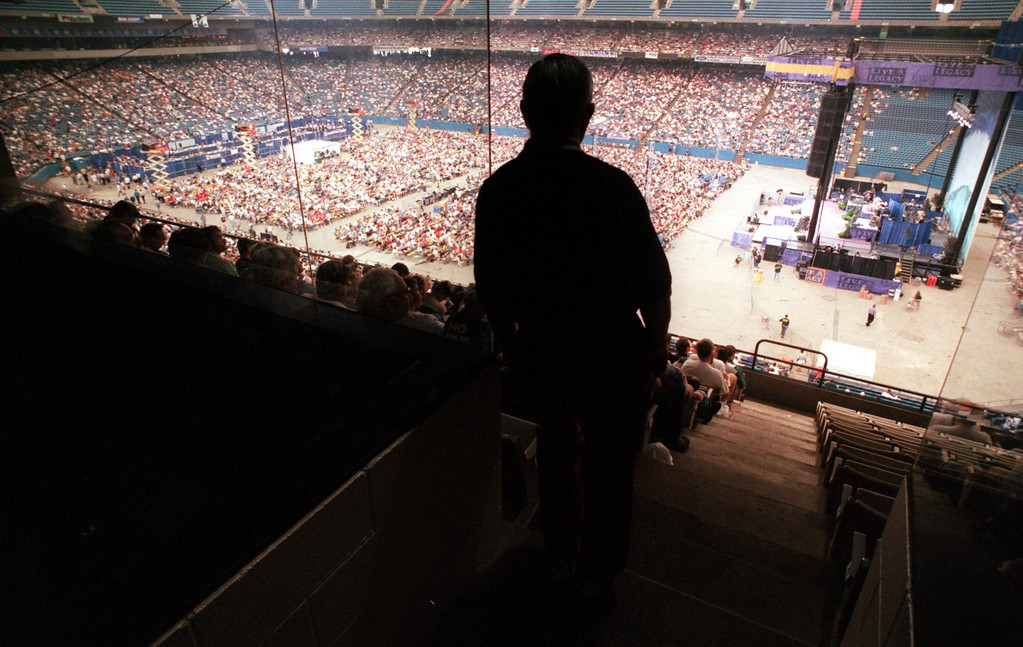 Description of . A Promise Keeper listens to the message during their rally at the Pontiac Silverdome.