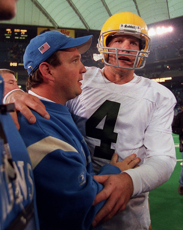 . Detroit Lions Head Coach Marty Mornhinweg (left) gets a consolation hug from Green Bay Packers Quarterback Brett Favre as they leave the field following the Detroit Lions 29-27 loss Thursday at the Pontiac Silverdome.