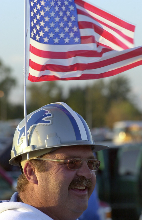 Description of . Fred Freeman of Clarkston displays his patriotic and team spirit as he tailgates in the parklot of Pontiac Silverdome prior to the start of the Detroit Lions home game against the St. Louis Rams on Monday Night Football. Security around the country has increased at all football stadiums due to the terrorist attack on Sept. 11, 2001.