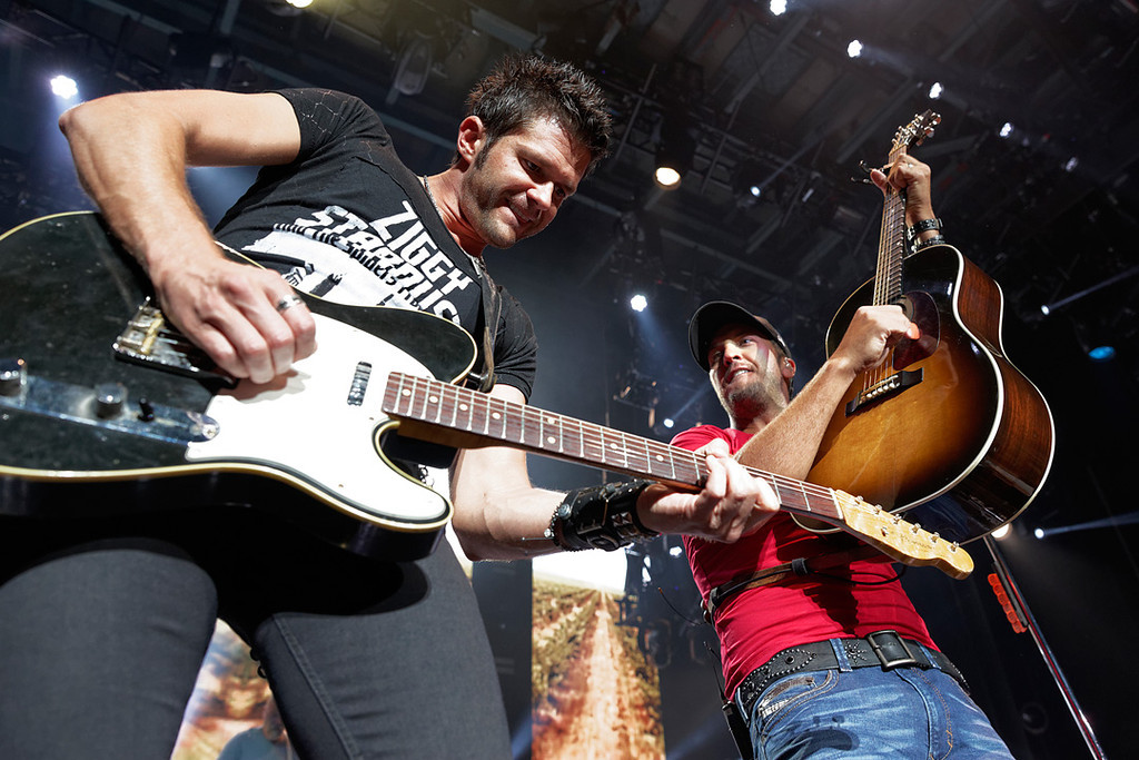 Description of . Luke Bryan (right) performs June 18, 2014, in the first of two concerts at DTE Energy Music Theatre. Photo by Ken Settle
