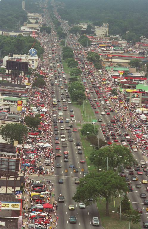 Description of . Saturday afternoon, the Woodward Dream Cruise is in full swing as traffic fills both north and southbound Woodward Ave.  This is looking southbound toward Royal Oak from Birmingham area.