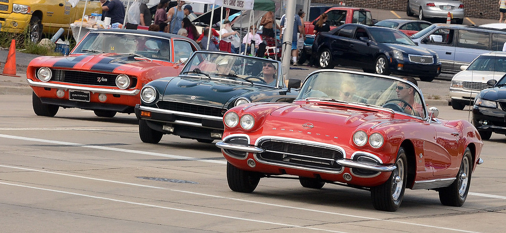 Description of . Cruisers head south on Woodward Avenue in Pontiac during the 2013 Woodward Dream Cruise, Saturday August 17, 2013. (Oakland Press Photo:Vaughn Gurganian)