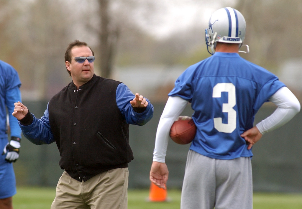 . Detroit Lions quarterback and first round draft pick Joey Harrington (right,#3) gets instruction from head coach Mary Mornhinweg during mini-camp, Saturday, April 26, 2002, in Allen Park, Mich.