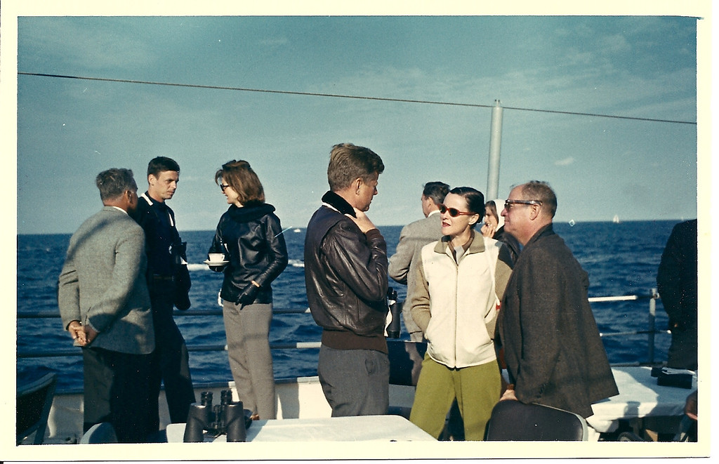 Description of . George Plimpton watches the America's Cup races with President John F. Kennedy and Jacqueline Kennedy, 1962 (Photo: Laemmle Zeller Films)