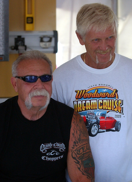 Description of . (left) Paul Teutul, Sr., star of the televison series Orange County Choppers, has his picture taken with Ron Campbell while making an appearance during the 16th Annual Woodward Dream Cruise in Royal Oak. (Oakland Press Photo/Vaughn Gurganian)
