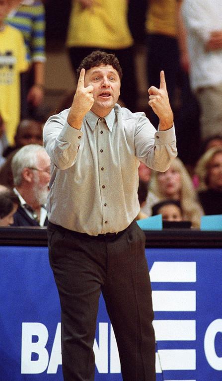 Description of . File art from the Oakland University vs Michigan game 11-16-01. Oakland University head basketball coach Greg Kampe.