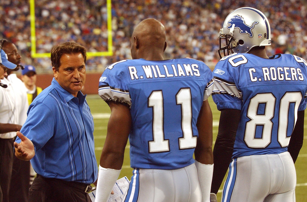 . Lions head coach Steve Mariucci chats with WR Roy Williams (11) Charles Rogers (80) on the sideline during Saturday\'s pre-season game against the Celevand Browns during Saturday\'s pre-season game played at Ford Field. The Lions lost 21-13.