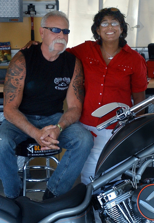 . (left) Paul Teutul, Sr., star of the televison series Orange County Choppers, has his picture taken with Maria Baker while making an appearance during the 16th Annual Woodward Dream Cruise in Royal Oak. (Oakland Press Photo/Vaughn Gurganian)
