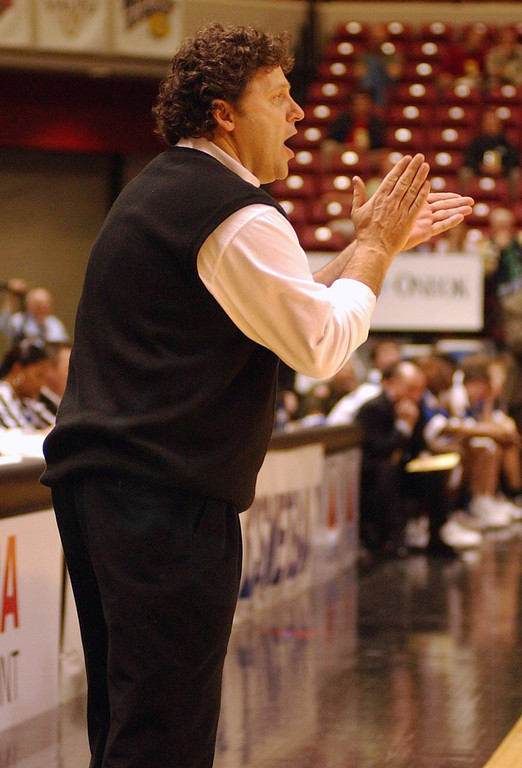 Description of . Oakland University men's basketball head coach Greg Kampe cheers on his team against UMKC during second half action, Saturday, March 5, 2005, at the John Q. Hammons Arena in Tulsa, Okla.  Oakland beat UMKC, 67-63, to advance to the second round of the Mid-Continent Conference Basketball Championships.